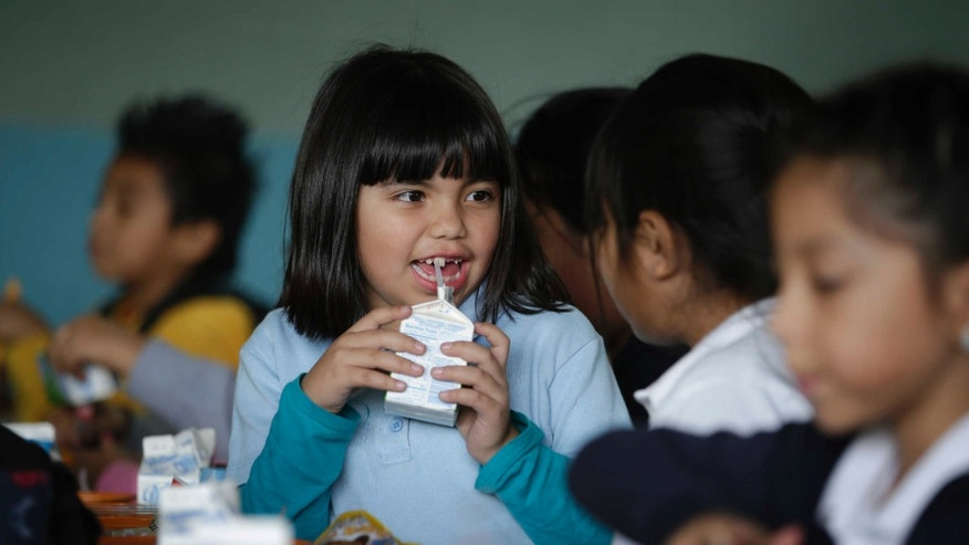 Jan. 13, 2015: Hazel Loarca, 7, drinks her milk in the cafeteria area at Kingsley Elementary School
