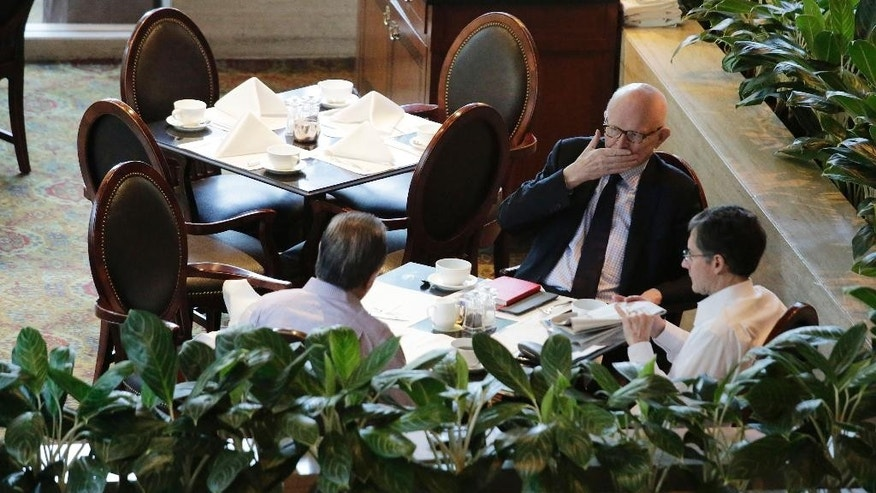 Former U.S. special envoy for North Korea policy Stephen Bosworth, top, Joseph DeTrani, bottom right, and Tony Namkung, left, meet during breakfast ahead of meetings with North Korean officials, Sunday, Jan. 18, 2015 in Singapore. North Korea's chief nuclear envoy and former U.S. negotiators and security experts were in Singapore to discuss nuclear issues at meetings which started Sunday and will be held over two days. (AP Photo/Wong Maye-E)