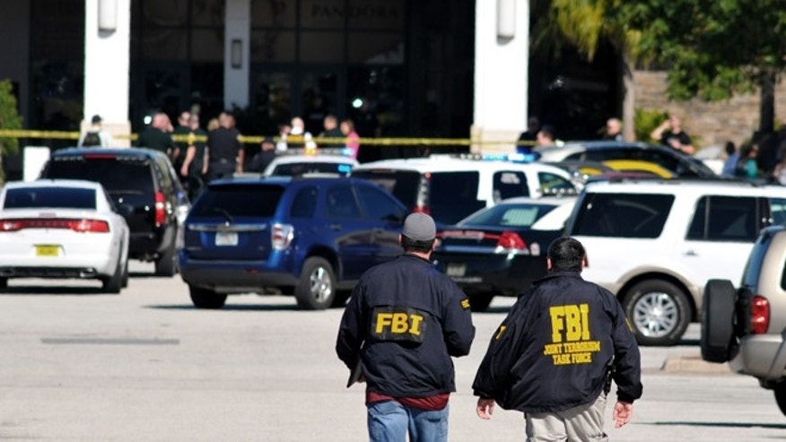Jan. 17, 2015: Law enforcement including the FBI respond to the scene of a shooting at the Melbourne Square Mall in Melbourne, Fla. (AP/Florida Today, Malcolm Denemark)