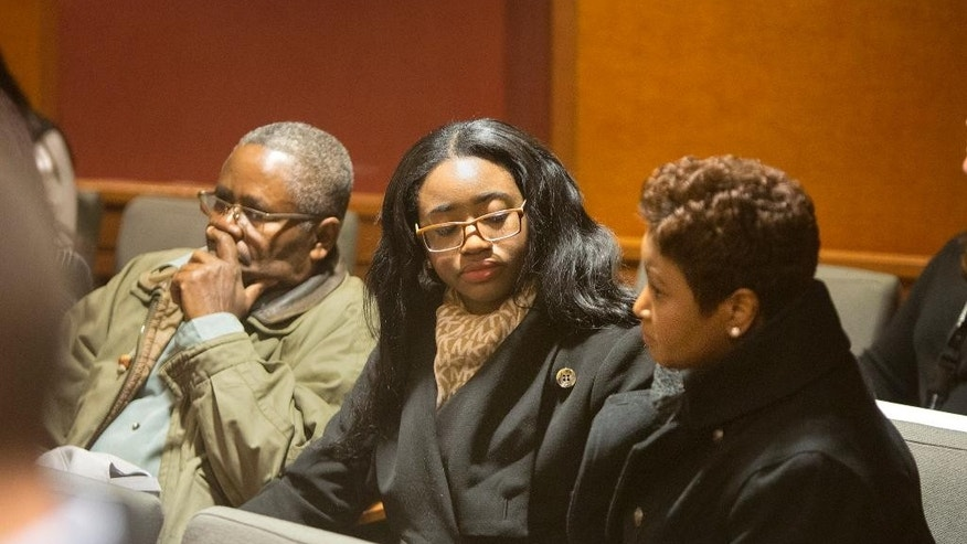 Members of Hyphernkemberly Dorvillier's family, including her mother Juana Scully, right, sit in the back of the courtroom during her initial court appearance via teleconference at the Burlington County N.J. Courthouse in Mount Holly, N.J., Tuesday, Jan. 20, 2015. Dorvillier is accused of killing her newborn baby by immolation. The judge maintained her $500,000 bail, which was set after police found the baby in flames Jan. 16 in the middle of a residential road. (AP Photo/The Philadelphia Inquirer, Ed Hille, Pool)