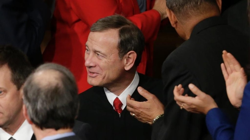Chief Justice John Roberts arrives on  Capitol Hill in Washington, Tuesday, Jan. 20, 2015, for President Barack Obama;s State of the Union addre. (AP Photo/Pablo Martinez Monsivais)