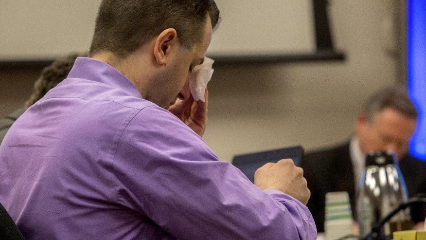 Joseph McEnroe wipes his head as he waits for proceedings to begin in King County Superior Court Tuesday, Jan. 20, 2015 in Seattle. Opening statements were made Tuesday in his trial for the murder of six members of a family on Christmas Eve 2007.   (AP Photo/The Seattle Times, Ellen M. Banner, Pool)