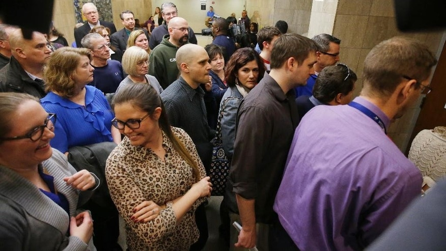 Spectators enter the court room for the Monserrate Shirley plea hearing, Tuesday, Jan. 20, 2015, in Indianapolis. Shirley changed her plea to guilty to two counts of conspiracy to commit arson and may not have to serve any prison time under the terms of the deal. (AP Photo/Darron Cummings)