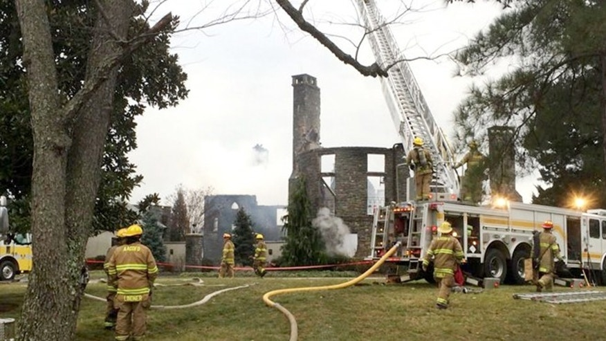 Jan. 19, 2015: Firefights work to put out a fire at a home on Childs Point Road, in Annapolis, Md.