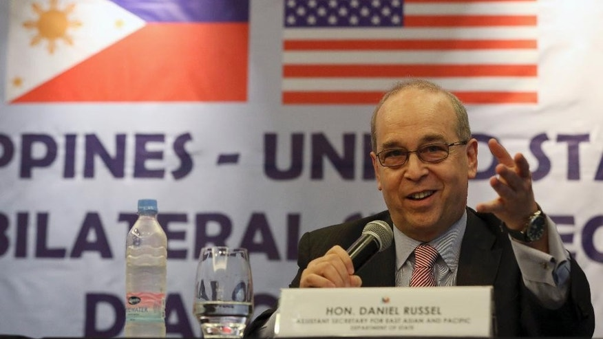 U.S. Assistant Secretary of State Daniel Russel gestures during a press conference with his Philippine counterpart on the fifth Philippines-United States Bilateral Strategic Dialogue in Manila, Philippines Wednesday, Jan. 21, 2015. Russel and a Philippine official said that their countries have separately urged Beijing to stop activities that ignite tensions and violate a 2002 accord designed to prevent armed conflicts over contested islands and reefs. (AP Photo/Aaron Favila)