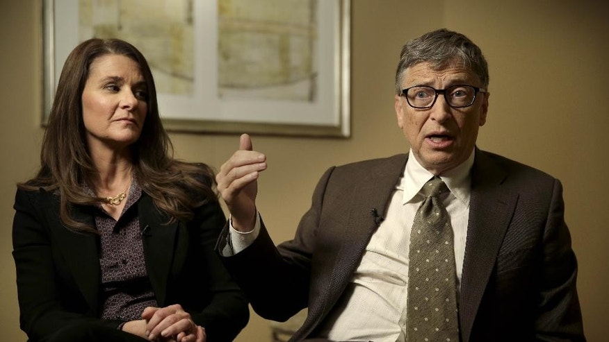 Melinda Gates listens while her husband Bill Gates talks during an interview in New York, Wednesday, Jan. 21, 2015. As the world decides on the most crucial goals for the next 15 years in defeating poverty, disease and hunger, the $42 billion Gates Foundation announces its own ambitious agenda. (AP Photo/Seth Wenig)