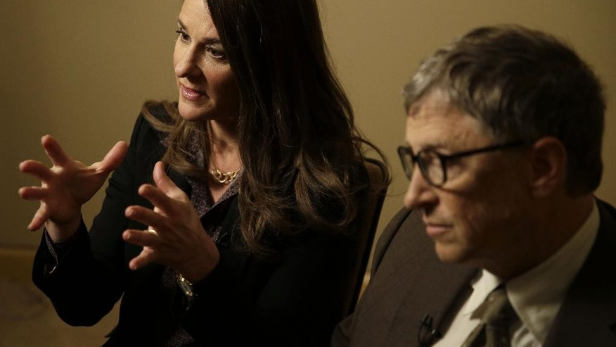 Bill Gates listens while his wife Melinda Gates talks during an interview in New York, Wednesday, Jan. 21, 2015. As the world decides on the most crucial goals for the next 15 years in defeating poverty, disease and hunger, the $42 billion Gates Foundation announces its own ambitious agenda. (AP Photo/Seth Wenig)