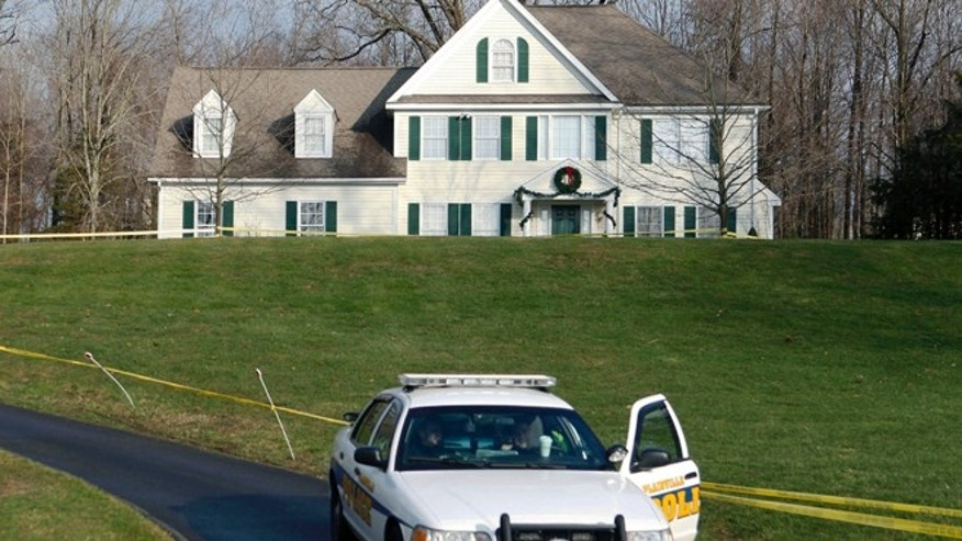 Dec. 18, 2012: A police cruiser sits in the driveway of the home of Nancy Lanza, in Newtown, Conn. (AP)