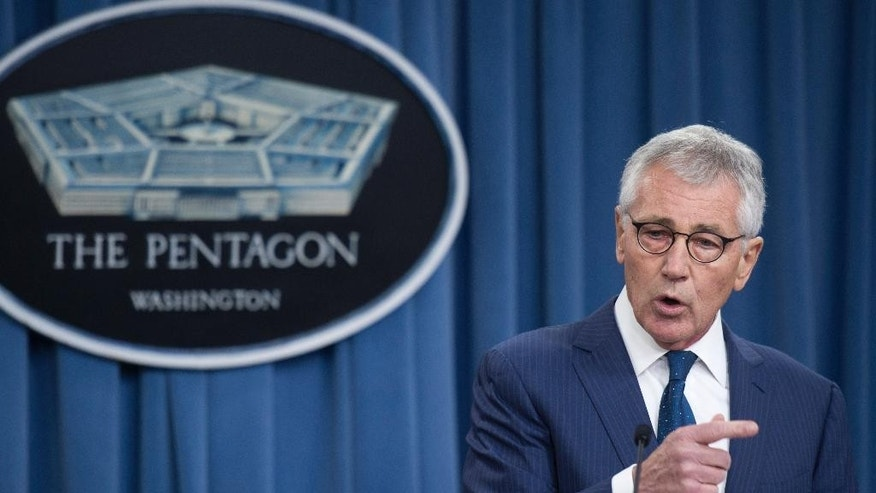 Outgoing Defense Secretary Chuck Hagel gestures during a news conference at the Pentagon, Thursday, Jan. 22, 2015. (AP Photo/Cliff Owen)