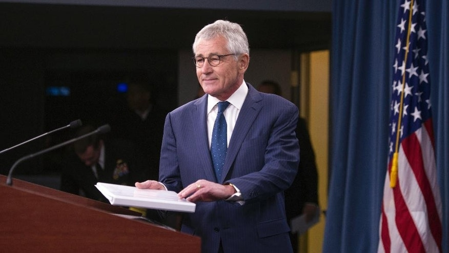 Outgoing Defense Secretary Chuck Hagel walks to a podium for a news conference at the Pentagon, Thursday, Jan. 22, 2015. (AP Photo/Cliff Owen)