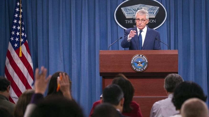 Outgoing Defense Secretary Chuck Hagel calls on a reporter during a news conference at the Pentagon, Thursday, Jan. 22, 2015. (AP Photo/Cliff Owen)