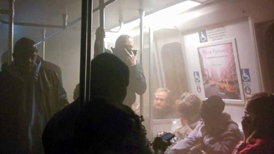 FILE - In this Jan. 12, 2015 file photo, smoke fills a Washington Metro system subway car near the L'Enfant Plaza station in Washington. (AP Photo/Andrew Litwin)