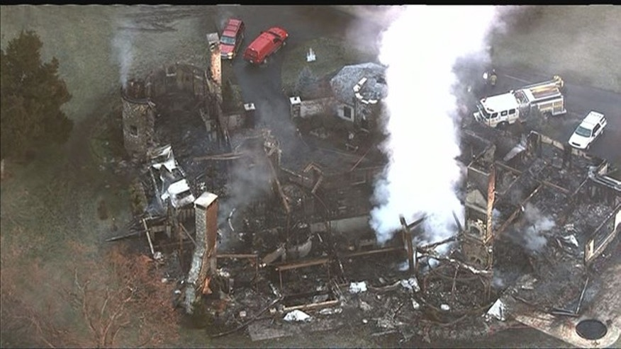 Jan. 23, 2015: This photo shows the remains of an Annapolis, Md. mansion destroyed by fire Monday. Four bodies have been recovered from the rubble, with 2 people unaccounted for. (MyFoxDC.com)