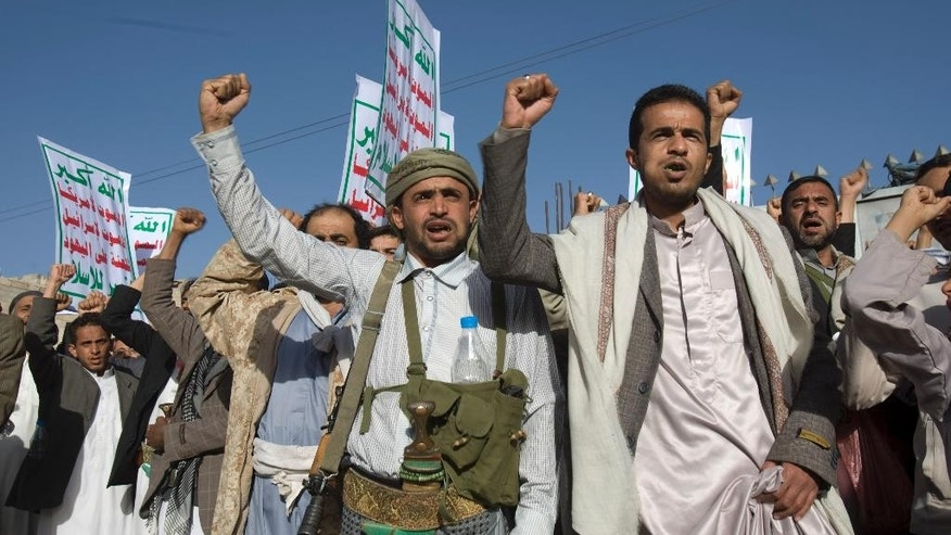 "Yemeni protesters chant slogans during a demonstration to show their support for Houthi Shiite rebels in Sanaa, Yemen, Friday, Jan. 23, 2015. Thousands of protesters demonstrated Friday across Yemen, some supporting the Shiite rebels who seized the capital and others demanding the country's south secede after the nation's president and Cabinet resigned. Arabic on the posters reads, ""God is great. Death to America. Death to Israel. A curse on the Jews. Victory to Islam."" (AP Photo/Hani Mohammed)"