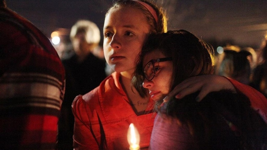 "This Saturday, Jan. 3, 2015 photo shows Anne Neal, left, embracing Alysia Jones after they both spoke at the vigil at Kings Mills High School to remember the life of Leelah Alcorn, a 17 year-old transgender girl who committed suicide, in Kings Mills, Ohio.  In what's believed to be her final message, Alcorn implored: ""My death needs to mean something."" It has, at least making her a poignant new face for the transgender movement and those struggling to fit in. (AP Photo/The Enquirer, Meg Vogel)"