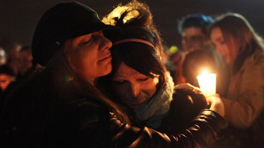 "This Saturday, Jan. 3, 2015 photo shows Tiffany Neri, left, embracing Cassie Thompson during a group hug at the end of the vigil to remember the life of Leelah Alcorn, a 17 year-old transgender girl who committed suicide, in Kings Mills, Ohio.  In what's believed to be her final message, Alcorn implored: ""My death needs to mean something."" It has, at least making her a poignant new face for the transgender movement and those struggling to fit in. (AP Photo/The Enquirer, Meg Vogel)"