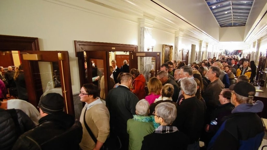 Hundreds of people line up to attend or testify at the House State Affairs Committee hearing on a bill that would include sexual orientation and gender identity protections to the state's Human Rights Act, at the state Capitol building, Monday, Jan. 26, 2015, in Boise, Idaho. (AP Photo/Otto Kitsinger)
