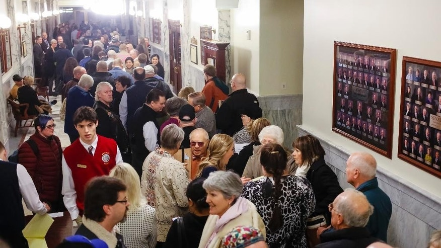 People line up to attend or testify at the House State Affairs Committee hearing on a bill that would include sexual orientation and gender identity protections to the state's Human Rights Act, at the state Capitol building, Monday, Jan. 26, 2015, in Boise, Idaho. (AP Photo/Otto Kitsinger)