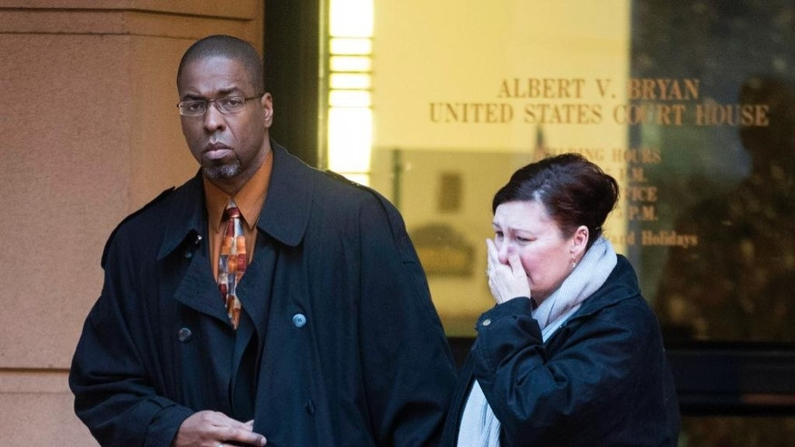 Former CIA officer Jeffrey Sterling leaves the Alexandria Federal Courthouse, Monday, Jan. 26, 2015, in Alexandria, Va., with his wife, Holly, after being convicted on all nine counts he faced of leaking classified details of an operation to thwart Iran's nuclear ambitions to a New York Times reporter. (AP Photo/Kevin Wolf)