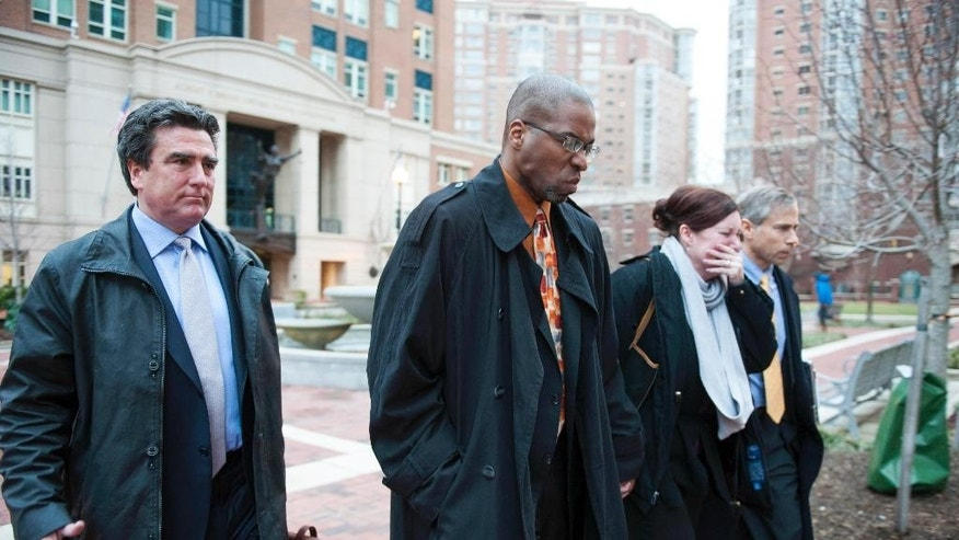 Former CIA officer Jeffrey Sterling, second from left, leaves the Alexandria Federal Courthouse Monday, Jan. 26, 2015, in Alexandria, Va., with his wife, Holly, second from right, attorney Barry Pollack, right, and attorney Edward MacMahon, after he was convicted on all nine counts he faced of leaking classified details of an operation to thwart Iran's nuclear ambitions to a New York Times reporter. (AP Photo/Kevin Wolf)