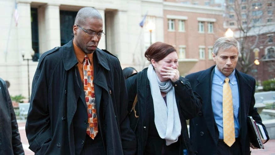 Former CIA officer Jeffrey Sterling, left, leaves the Alexandria Federal Courthouse Monday, Jan. 26, 2015, in Alexandria, Va., with his wife, Holly, center and attorney Barry Pollack, after being convicted on all nine counts he faced of leaking classified details of an operation to thwart Iran's nuclear ambitions to a New York Times reporter. (AP Photo/Kevin Wolf)