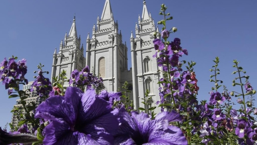 "FILE- In this Sept. 3, 2014, file photo, shows flowers blooming in front of the Salt Lake Temple. in Temple Square, in Salt Lake City. Mormon church leaders are making a national appeal for a ""balanced approach"" in the clash between gay rights and religious freedom. The church is promising to support some housing and job protections for gays and lesbians in exchange for legal protections for believers who object to the behavior of others.  (AP Photo/Rick Bowmer, File)"