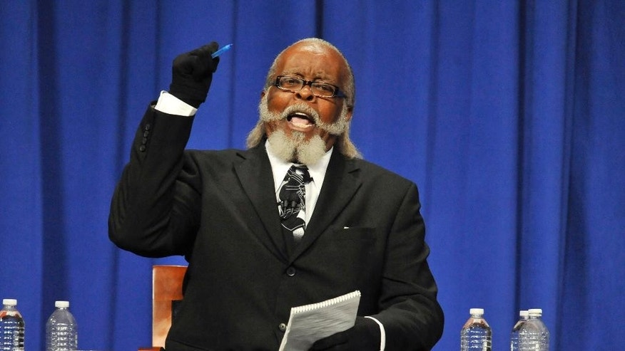 FILE - In this Oct. 18, 2010, file photo, candidate Jimmy McMillan makes a point during the New York State Gubernatorial debate held at Hoftstra University in Hempstead, N.Y. McMillan, who ran for governor in 2010, said Tuesday he's facing an eviction notice that says he has to leave his rent-stabilized Manhattan apartment on St. Mark's Place by Feb. 5, 2015. (AP Photo/Kathy Kmonicek, File)