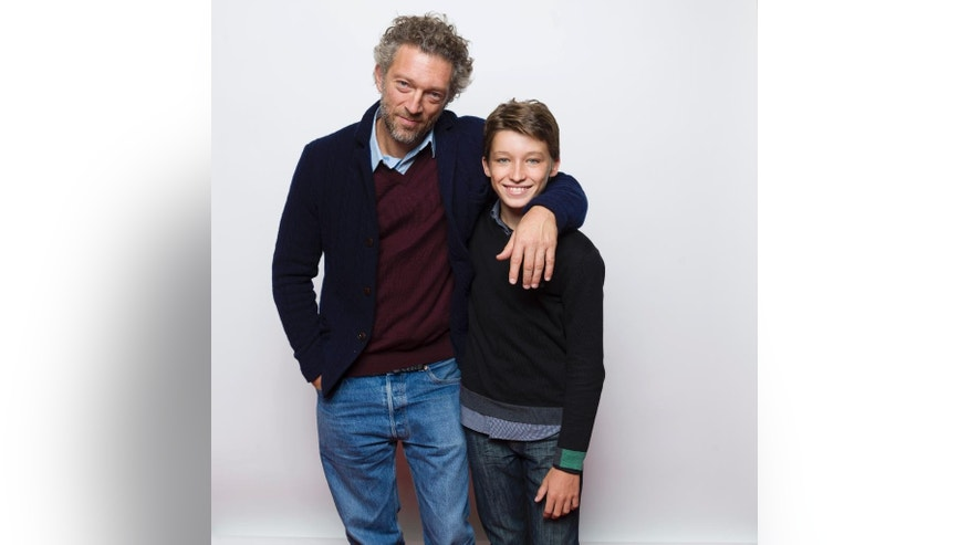 "In this Jan. 26, 2015 photo, Vincent Cassel, left, and Jeremy Chabriel pose for a portrait to promote the film, ""Partisan"", at the Eddie Bauer Adventure House during the Sundance Film Festival in Park City, Utah. (Photo by Victoria Will/Invision/AP)"