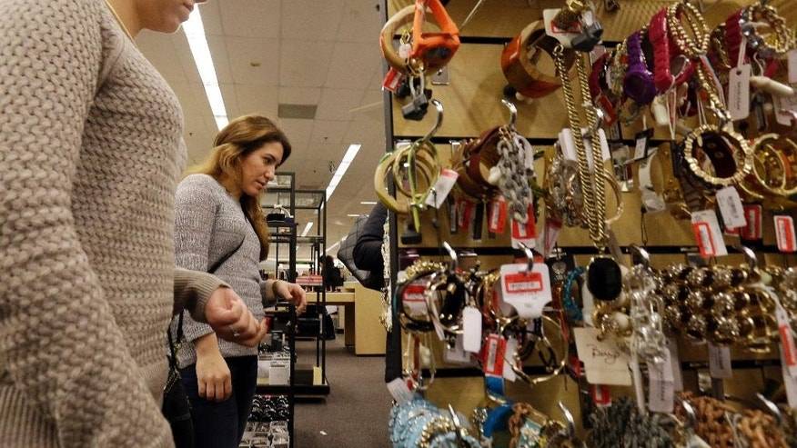 FILE - In this Dec. 26, 2014 file photo, customers shop at Nordstrom Rack in Schaumburg, Ill. The Conference Board releases the Consumer Confidence Index for January on Tuesday, Jan. 27, 2015. (AP Photo/Nam Y. Huh, File)