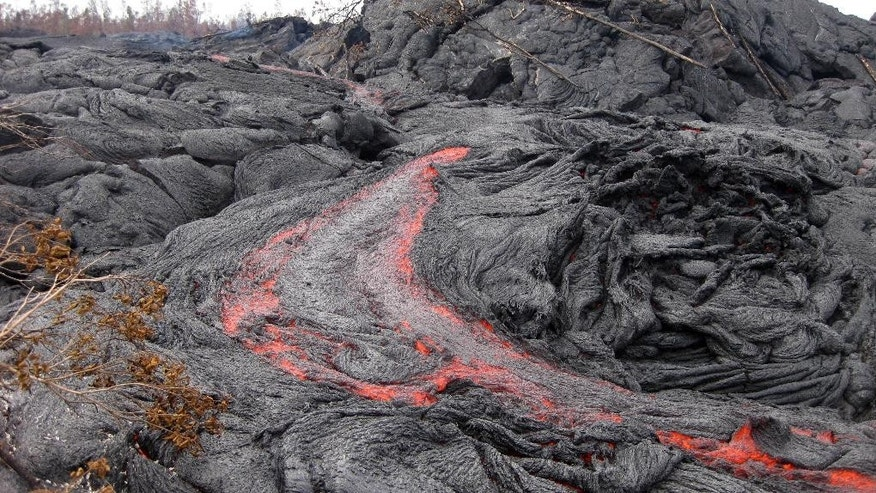 This Jan. 26, 2015 photo released by the U.S. Geological Survey shows one of many small breakouts of lava on the surface of the June 27 flow immediately upslope of the leading edge near the town of Pahoa on the Big Island of Hawaii. The public has a few days left to get a glimpse of Hawaii lava from a viewing area set up by the county. After slow-moving lava poured into the Pahoa trash transfer station, it was turned into a public viewing area last month. (AP Photo/U.S. Geological Survey)