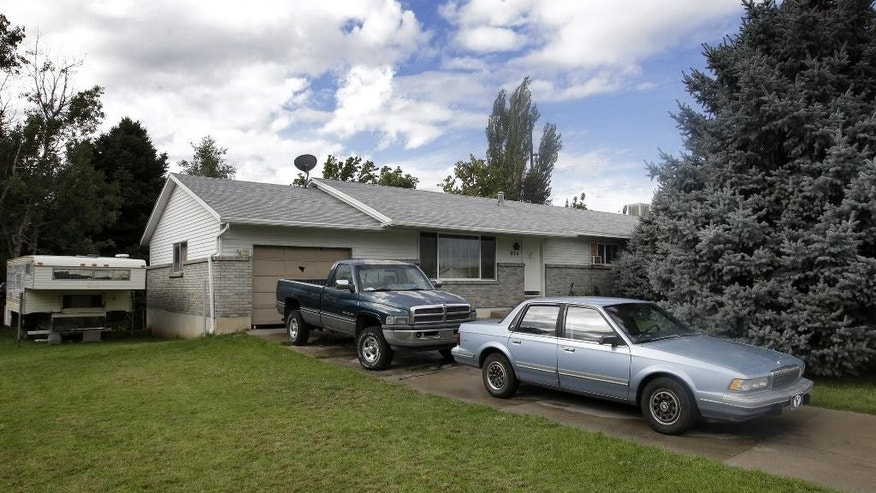 "FILE - This Sept. 28, 2014, file photo, shows the Springville, Utah home where five family members were found dead. Police say all five died from methadone and other drugs, and interviews with people who knew them revealed the parents worried about a ""pending apocalypse."" (AP Photo/Rick Bowmer, File)"