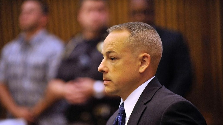 FILE - In this June 18, 2013 file photo, Detroit police officer Joseph Weekley stands in Judge Cynthia Hathaway's courtroom at the Frank Murphy Hall of Justice in Detroit.  Wayne County Prosecutor Kym Worthy said her office told Aiyana Stanley-Jones' family Wednesday, Jan. 28, 2015 that she will move to dismiss the case against  Weekley. Aiyana was shot in the head while she slept in May 2010. The shooting was not considered intentional. (AP Photo/The Detroit News, John T. Greilick) DETROIT FREE PRESS OUT; HUFFINGTON POST OUT