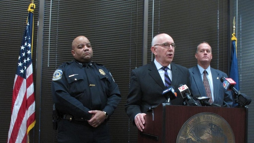 Marion County Prosecutor Terry Curry (at podium) speaks on Thursday, Jan. 29, 2015, during a news conference in Indianapolis about charges filed against a fourth person in an Indianapolis house explosion that killed two people and damaged dozens of homes. Indianapolis Police Chief Rick Hite stands to Curry's right and city Homeland Security Director Gary Coons stands on Curry's left. Two counts of murder and dozens of arson charges were filed Thursday against 44-year-old Gary Thompson in the November 2012 natural gas explosion that killed a couple living next door. Prosecutors have said the explosion was a scheme to collect insurance money. (AP Photo/Rick Callahan)