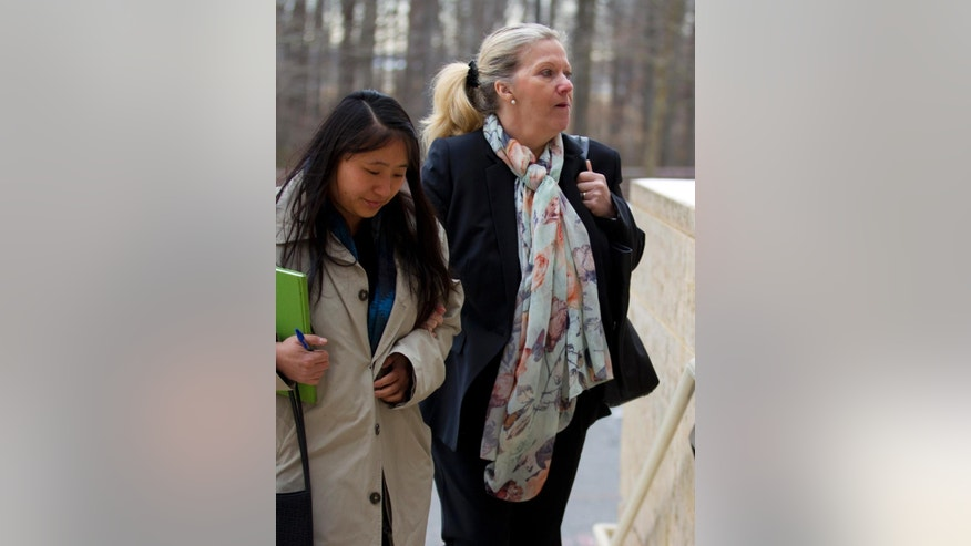 Sandra Dunham, right, arrives at U.S. District Court in Greenbelt, Md., Thursday, Jan. 29, 2015, for her sentencing. Dunham, a British woman extradited to the US with her husband to face fraud charges was to be sentenced Thursday in Maryland. She pleaded guilty in December to conspiring to commit wire fraud. A plea agreement calls for 30 days in jail and 30 days of home detention.  (AP Photo/Jose Luis Magana)