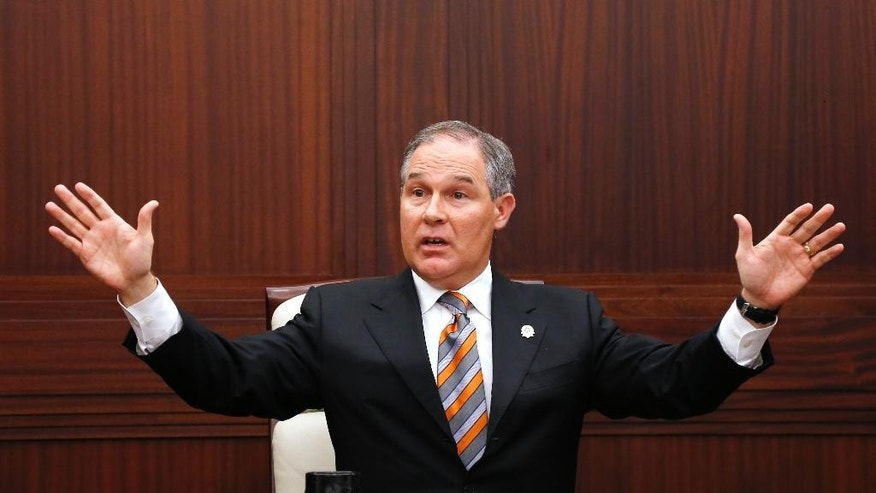 FILE - In this July 16, 2013 file photo, Oklahoma Attorney General Scott Pruitt gestures as he answers a question during a news conference in Oklahoma City.  While the U.S. Supreme Court considers whether Oklahoma's new lethal injection formula is constitutional, Pruitt said Thursday, Jan. 29, 2015, the state will proceed with executions if alternative drugs can be acquired. (AP Photo/Sue Ogrocki, File)