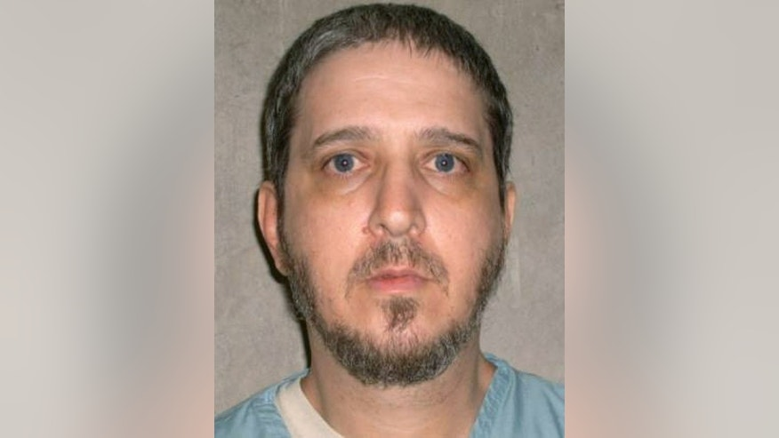 FILE- This file photo provided by the Oklahoma Department of Corrections shows death row inmate Richard Glossip. Glossip's scheduled execution is on hold while the U.S. Supreme Court considers whether Oklahoma's new lethal injection formula is constitutional. Oklahoma Attorney General Scott Pruitt said Thursday, Jan. 29, 2015, the state will proceed with executions if alternative drugs can be acquired.  (AP Photo/Oklahoma Department of Corrections, File)