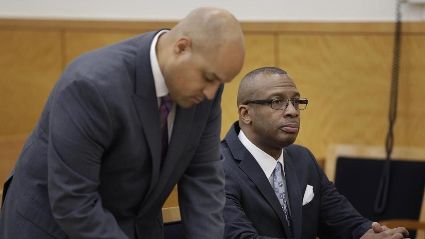 Michael Waithe sits in a courtroom while waiting to be exonerated in New York, Thursday, Jan. 29, 2015.  A state Supreme Court judge granted a prosecutor's motion to vacate Waithe's 1987 burglary conviction.   Brooklyn District Attorney Ken Thompson says in a statement Waithe came to the U.S. seeking a better life but was instead framed for a crime he didn't commit. The green card-holder faces deportation based on the conviction. (AP Photo/Seth Wenig)