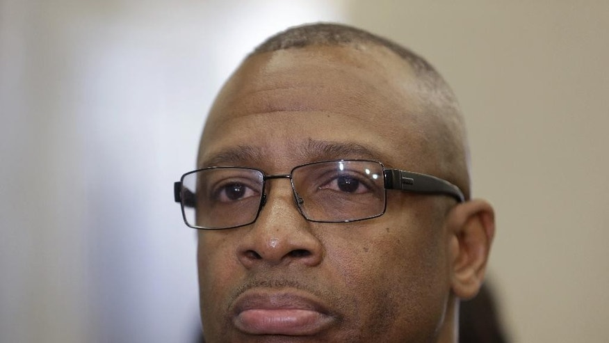 Michael Waithe talks with reporters after leaving a courtroom in New York, Thursday, Jan. 29, 2015.  A state Supreme Court judge granted a prosecutor's motion to vacate Waithe's 1987 burglary conviction.   Brooklyn District Attorney Ken Thompson says in a statement Waithe came to the U.S. seeking a better life but was instead framed for a crime he didn't commit. The green card-holder faces deportation based on the conviction.(AP Photo/Seth Wenig)