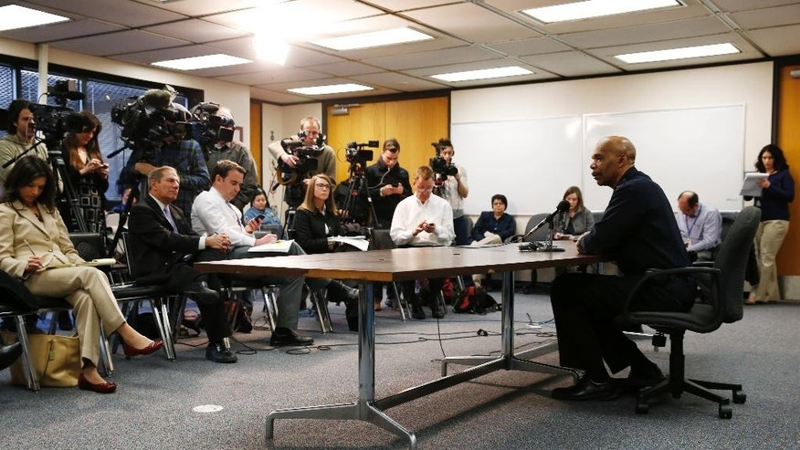 Denver Police Department Chief Robert White, right, responds to questions during a news conference in Denver, Thursday, Jan. 29, 2015, about the death of a 17-year-old woman who was killed after she allegedly hit and injured a Denver Police Department officer while driving a stolen vehicle early Monday in a northeast Denver alley. (AP Photo/David Zalubowski)