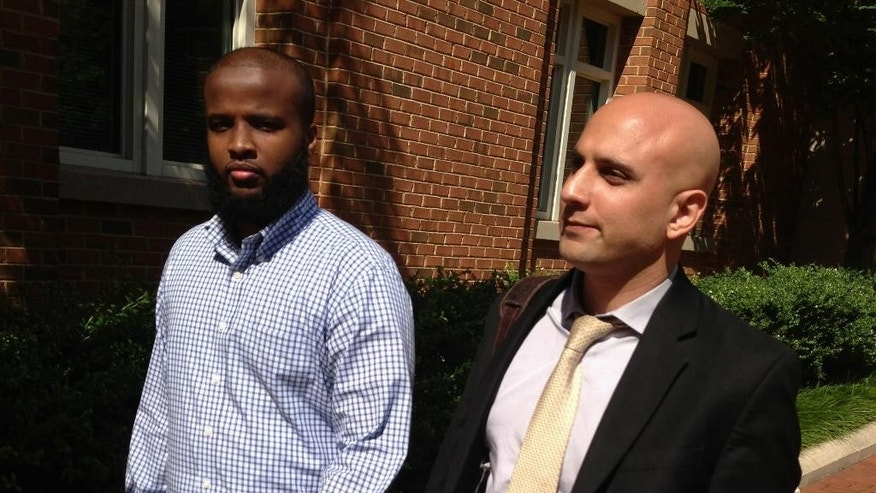 "DELETES REFERENCE TO GADEIR ABBAS ASSOCIATION TO THE COUNCIL ON AMERICAN-ISLAMIC RELATIONS - FILE - In this Aug. 16, 2013, file photo, Gulet Mohamed, left, leaves the federal court in Alexandria, Va. with his attorney, Gadeir Abbas, after a hearing challenging his placement on the government's no fly list. The FBI on Jan. 29, 2015, added Liban Haji Mohamed, a former taxi driver from northern Virginia to its list of most wanted terrorists, saying he was a recruiter for the al-Shabab terror group in Somalia. An arrest warrant, originally issued in February, was unsealed in U.S. District Court in Alexandria for Liban Haji Mohamed, 29, a naturalized U.S. citizen born in Somalia. The family denies that Mohamed committed any wrongdoing and suspects he went into hiding to avoid constant harassment from the FBI. ""Al-Shabab has killed Liban's uncle and imprisoned his cousins,"" said Abbas, who for years has represented Mohamed's brother in a civil-rights suit against the government. ""His family believes the allegations have no basis in fact."" (AP Photo/Matthew Barakat, File)"
