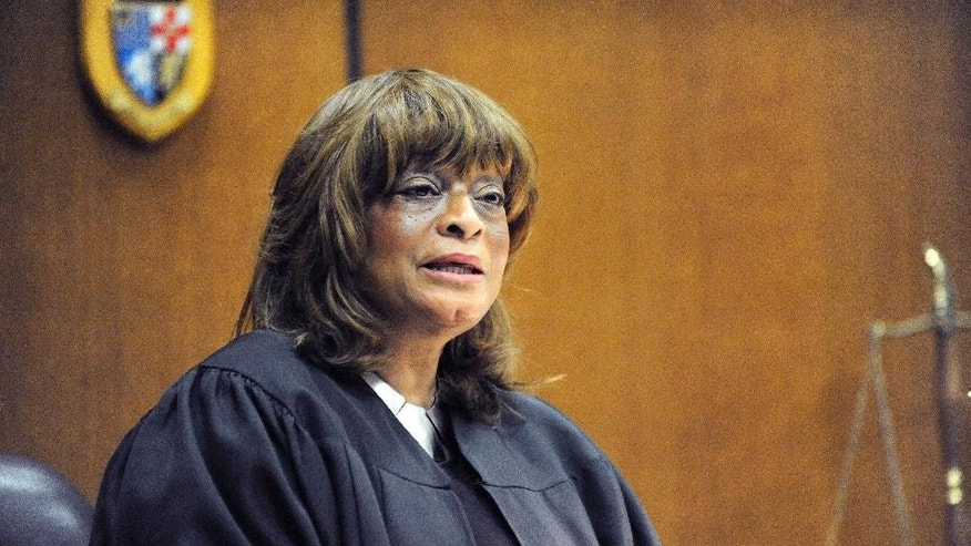 Judge Cynthia Gray Hathaway address the court at Frank Murphy Hall of Justice in Detroit on Friday, Jan. 30, 2015.  At the prosecutor's request, a Hathaway dismissed the last charge against Joseph Weekley, a Detroit police officer who fatally shot a 7-year-old girl during a raid.  Two trials against  Weekley ended without verdicts on a charge of reckless use of a gun.   Weekley shot Aiyana Stanley-Jones as she slept on a couch in a Detroit home in 2010. It occurred during a frenzied raid by elite officers who burst through the door to search for a murder suspect after throwing a flash grenade to confuse anyone inside. (AP Photo/Detroit News, David Coates)  DETROIT FREE PRESS OUT; HUFFINGTON POST OUT