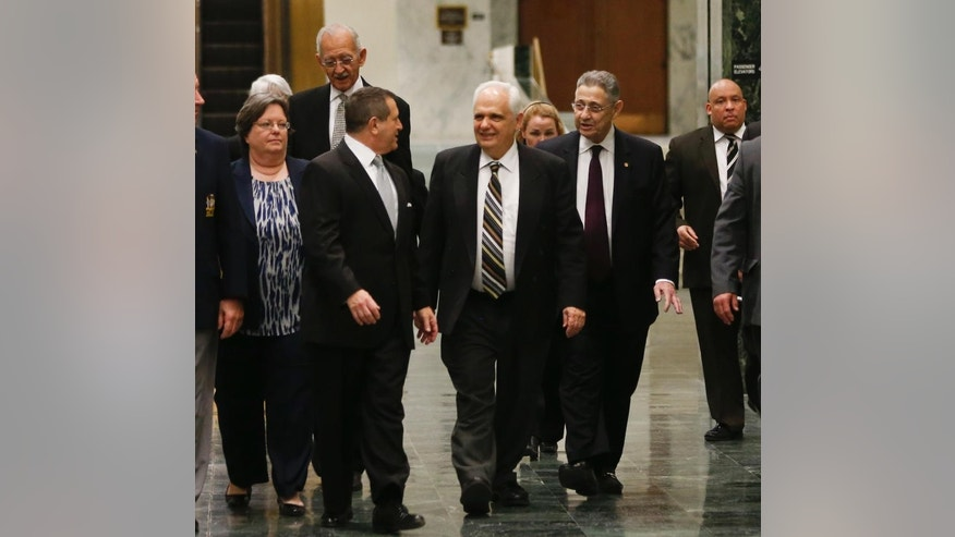 FILE--In this Jan. 26, 2015 file photo, Assembly Speaker Sheldon Silver, D-Manhattan, right, walks with Assembly members Catherine Nolan, D-Sunnyside, Herman Farrell Jr, D-Manhattan, Majority Leader Joseph Morelle, D-Rochester, and Joseph Lentol, D-Brooklyn, in Albany, N.Y.  Sheldon Silver announced his resignation as two lawmakers jockeyed for his position Friday, Jan. 30, 2015 following federal charges that the longtime leader took nearly $4 million in kickbacks.  Morelle dropped out of the race and threw his support to Assemblyman Carl Heastie, D-Bronx, who appears to have the job locked up. Assemblywoman Catherine Nolan of Queens remains the only other candidate.(AP Photo/Mike Groll, File)