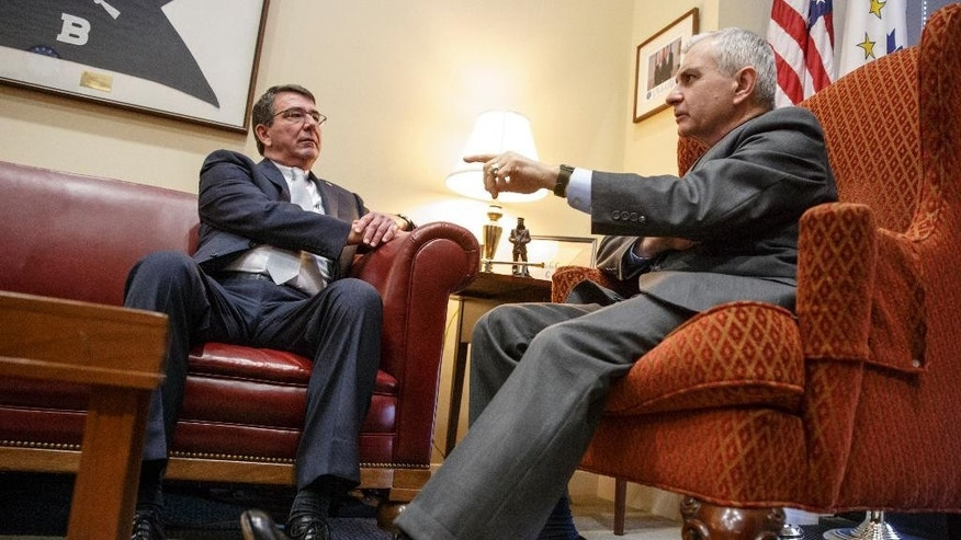 FILE - In this Jan. 22, 2015 file photo, Defense Secretary nominee, current Deputy Defense Secretary Ashton Carter, left, meets with Sen. Jack Reed, D-R.I., ranking member on the Senate Armed Services Committee, on Capitol Hill in Washington. (AP Photo/J. Scott Applewhite, File)