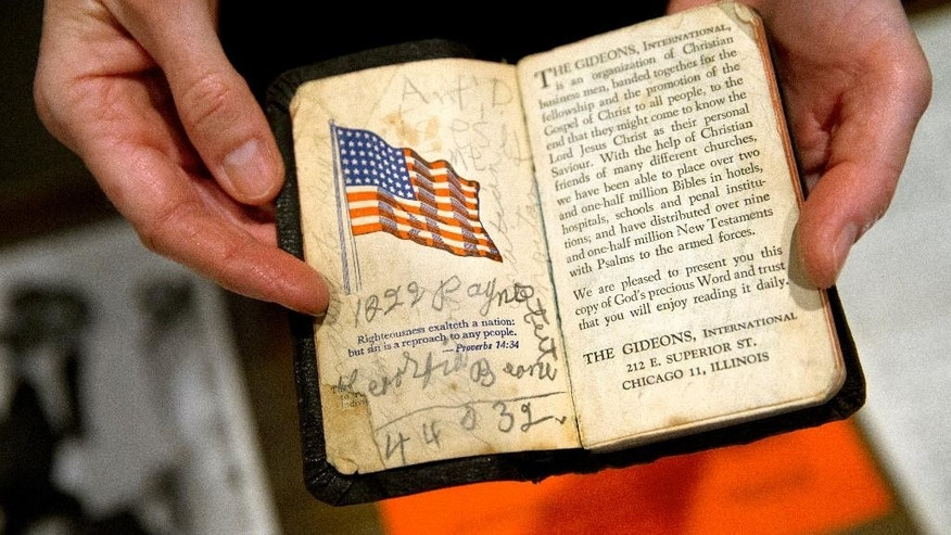 A personal bible that was carried by Rosa Parks is shown to members of the media during a media preview of the Rosa Parks archive at the Library of Congress, Madison Building, in Washington, Thursday, Jan. 29, 2015. (AP Photo/Jacquelyn Martin)