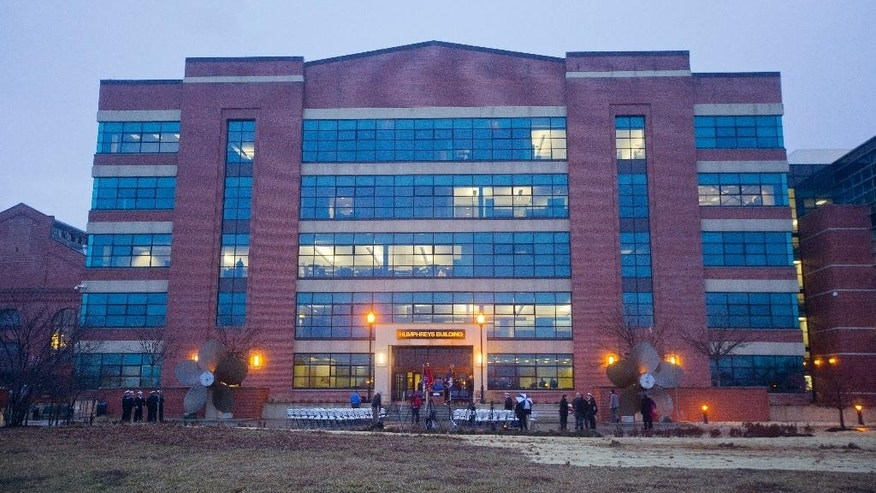 Joshua Humphreys Building, formerly know as building 197, is seen in the morning as Navy official gather for the reopening ceremony for the Naval Sea Systems Command's (NAVSEA) Headquarters building at the Washington Navy Yard, Monday, Feb. 2, 2015. The building was the site of the shooting rampage on Sept. 16, 2015, during which 12 people were killed and four wounded. (AP Photo/Pablo Martinez Monsivais )