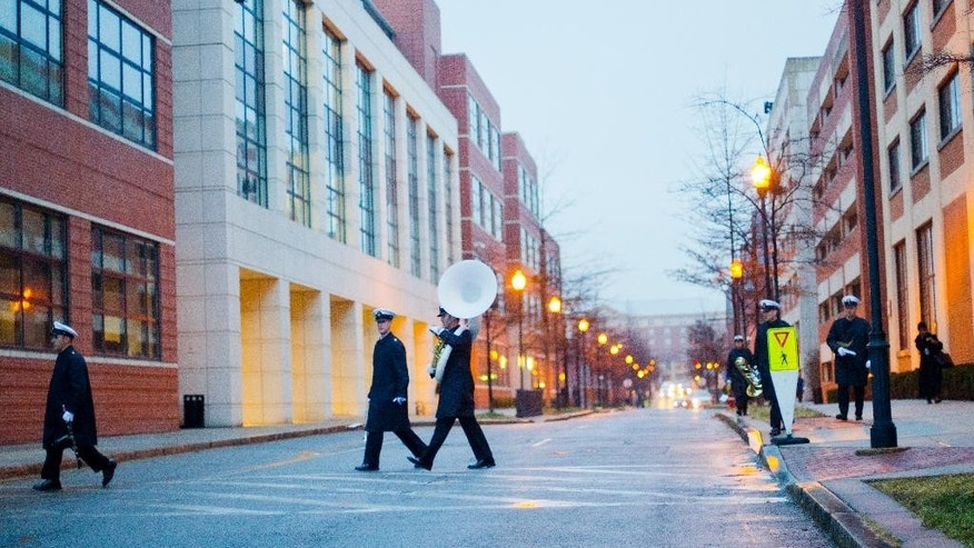 Members of the Navy band are seen arriving in the morning before participating in the reopening ceremony for the Naval Sea Systems Command's (NAVSEA) Headquarters building at the Washington Navy Yard, Monday, Feb. 2, 2015. The building was the site of the shooting rampage on Sept. 16, 2015, during which 12 people were killed and four wounded. (AP Photo/Pablo Martinez Monsivais )