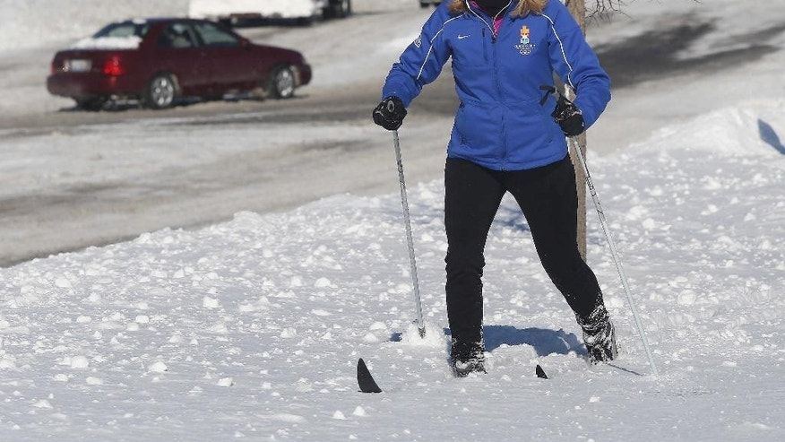 Vicki Abrams of Vernon Hills, Ill.  takes to cross-country skiing around town on Monday, Feb. 2, 2015, the day after a significant snowfall. (AP photo / Daily Herald,  Gilbert R. Boucher II  )