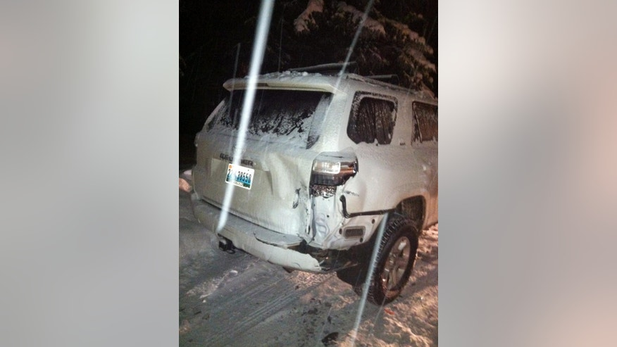 This Dec. 28, 2014 photo provided by the Aspen Police Department shows one of the two vehicles involved in a hit-and-run in Aspen, Colo. Disgraced cyclist Lance Armstrong hit two parked cars after a night of partying but agreed to let his longtime girlfriend take the blame to avoid national attention, police reports show. Aspen police cited Armstrong with failing to report an accident and speeding on Jan. 12, 2015, after the Dec. 28 accident, but only after his girlfriend, Anna Hansen, admitted to lying for him. (AP Photo/Aspen Police Department)