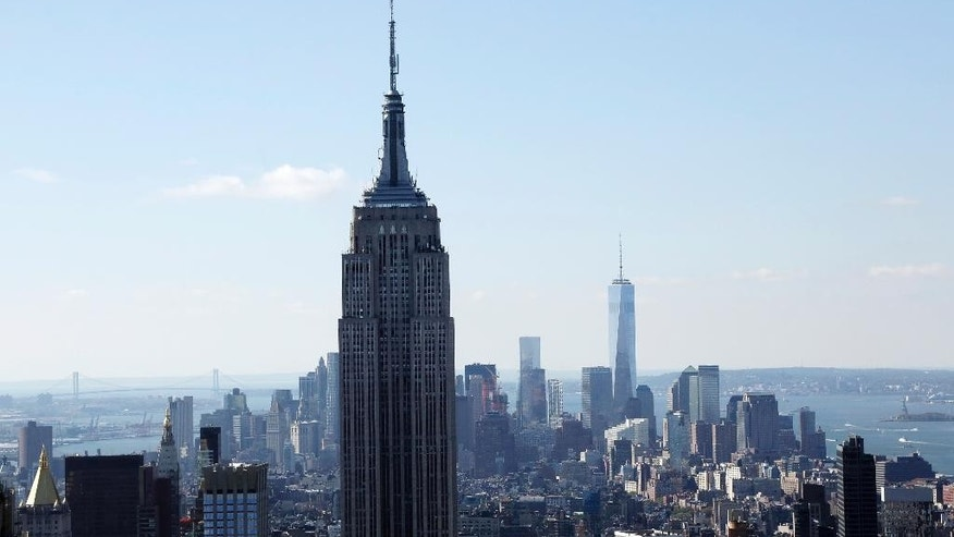 FILE - The Empire State Building and the Manhattan skyline are seen from the Rainbow Room, New York City's landmark restaurant atop 30 Rockefeller Plaza, in this Sunday, Oct. 5, 2014 file photo. Hundreds of people will take to the stairs at the Empire State Building on Wednesday night Feb. 4, 2015, climbing from the lobby to the 86th floor observatory. They'll be going up the 1,576 steps as part of the 38th annual Empire State Building Run-Up. (AP Photo/Mark Lennihan, File)