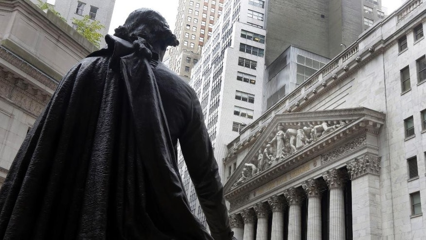 FILE - In this Oct. 2, 2014, file photo, the statue of George Washington on the steps of Federal Hall faces the facade of the New York Stock Exchange. U.S. stocks rose broadly in the first half-hour of trading Tuesday, Feb. 3, 2015, on higher oil prices and signs that the new Greek government won't press for a write-off of its bailout loans. European stocks were sharply higher, too. (AP Photo/Richard Drew, File)